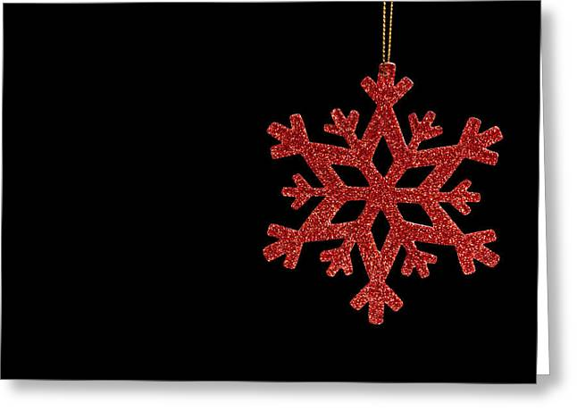 Twinkle Greeting Cards - Red snow flake on a black background Greeting Card by Ulrich Schade