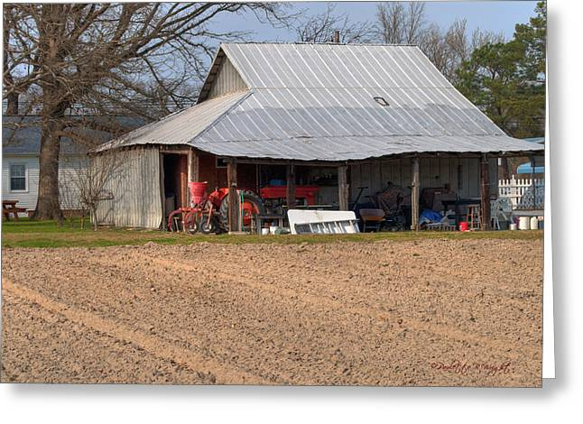 Red Tractor In A Tin Roofed Shed Greeting Card by Paulette B Wright