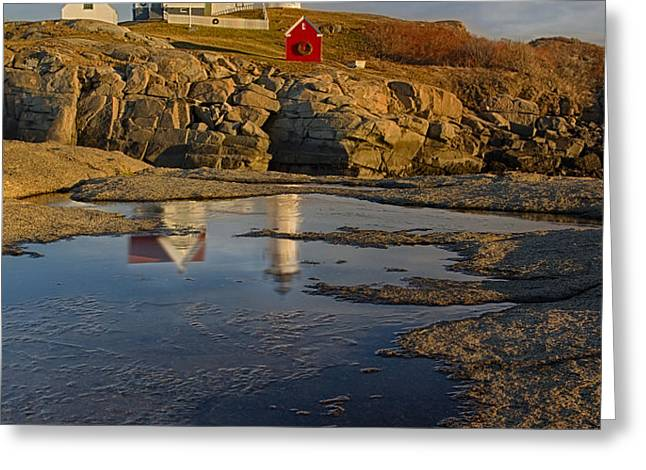 Reflecting On Nubble Lighthouse Greeting Card by Susan Candelario