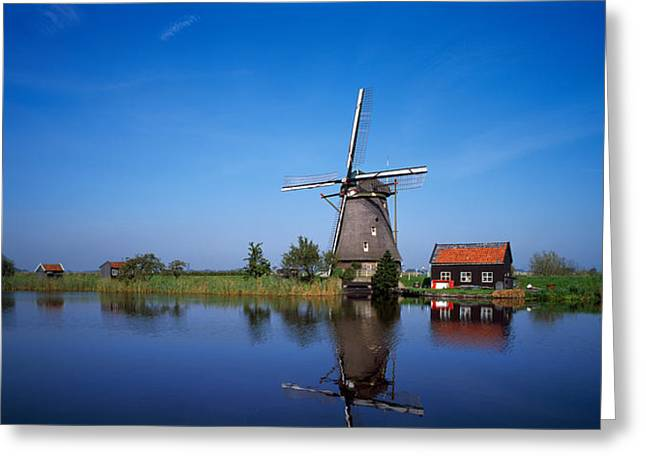 Windmill And Tree Greeting Cards - Reflection Of A Traditional Windmill Greeting Card by Panoramic Images