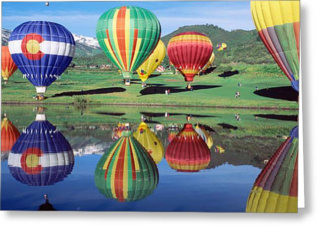 Hovering Greeting Cards - Reflection Of Hot Air Balloons On Greeting Card by Panoramic Images