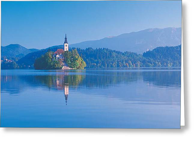 Bled Greeting Cards - Reflection Of Mountains And Buildings Greeting Card by Panoramic Images
