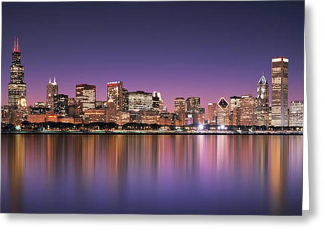 Panoramic Photography Greeting Cards - Reflection Of Skyscrapers In A Lake Greeting Card by Panoramic Images