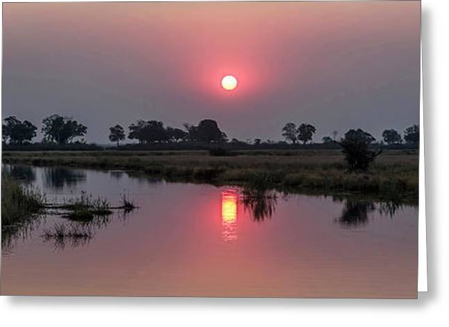 Reflection Of Sun In River At Dusk Greeting Card by Panoramic Images