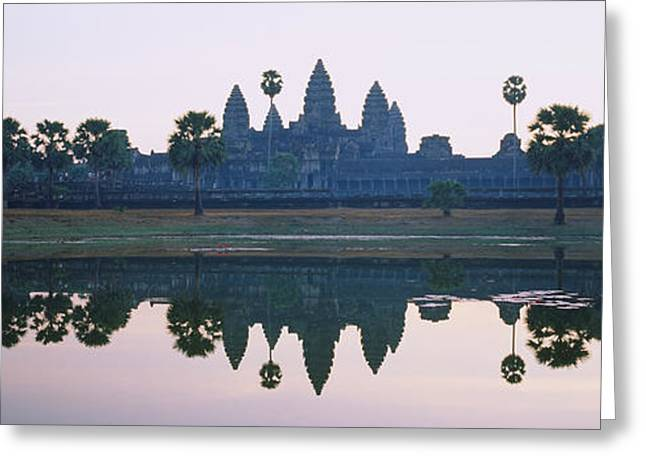 Siem Reap Greeting Cards - Reflection Of Temples And Palm Trees Greeting Card by Panoramic Images