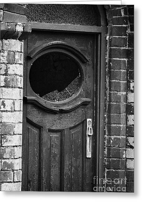 Terrorist Greeting Cards - Remains Of Bombed Out Brown Old Front Door With Smashed Window In Building Belfast Northern Ireland Greeting Card by Joe Fox