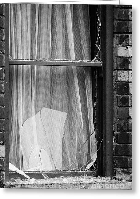 Terrorist Greeting Cards - Remains Of Bombed Out Window With Net Curtains And Broken Glass In Building Belfast Northern Ireland Greeting Card by Joe Fox