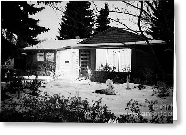 Covered Porch Greeting Cards - residential home at night in the snow with porch light on Saskatoon Saskatchewan Canada Greeting Card by Joe Fox