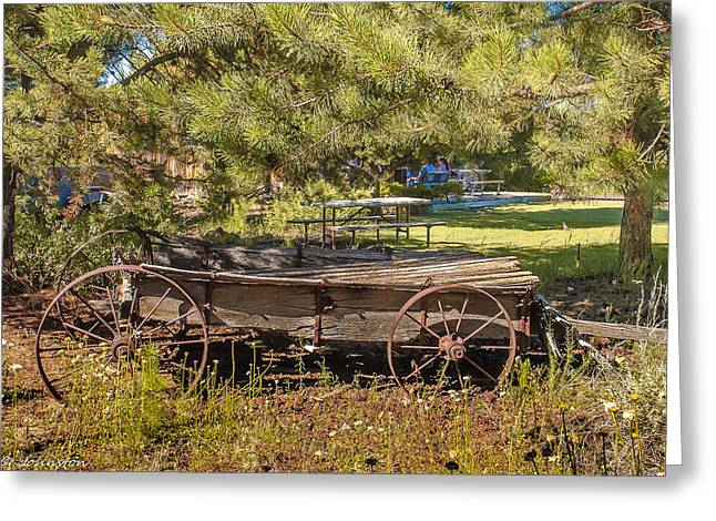 Old Western Photos Greeting Cards - Retired Wagon at Thousand Trails Greeting Card by  Bob and Nadine Johnston