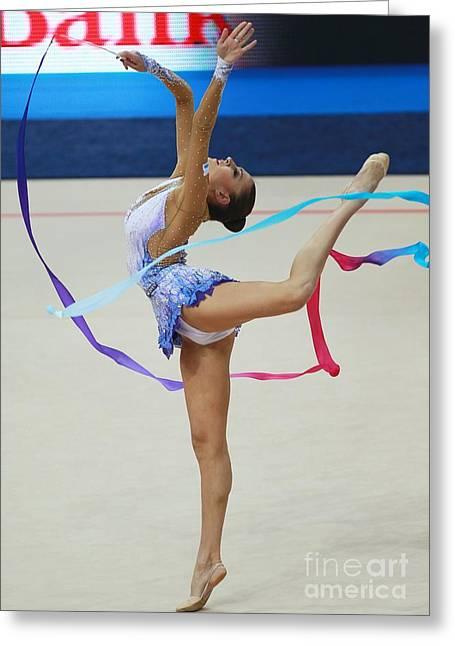 Rhythmic Greeting Cards - Rhythmic Gymnast Performing With Ribbon Greeting Card by Ria Novosti