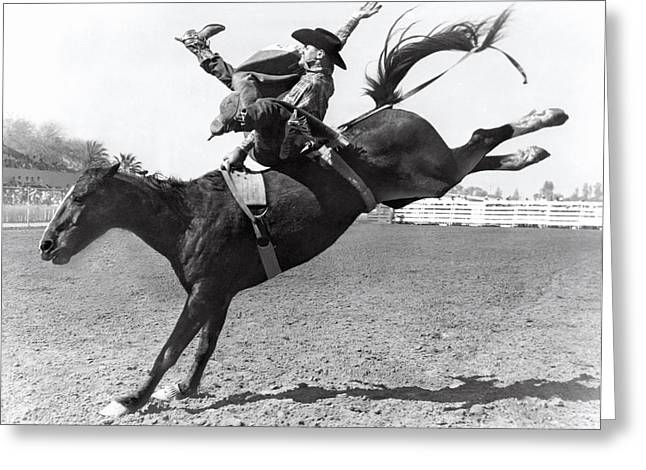 Riding A Bucking Bronco Greeting Card by Underwood Archives