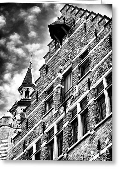 Medieval Buildings Greeting Cards - Rising Up in Bruges Greeting Card by John Rizzuto