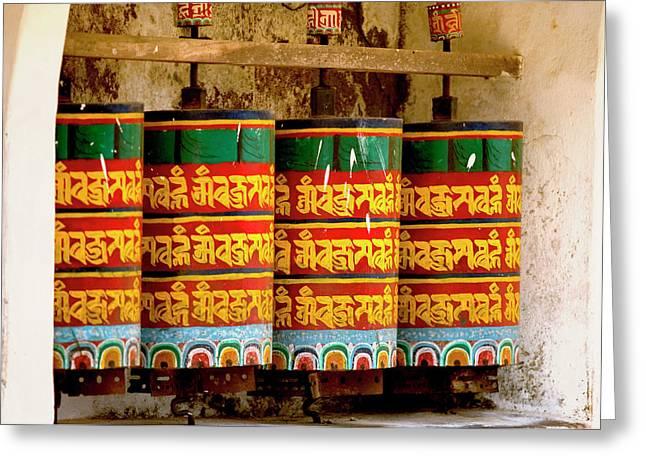 Ritual Prayer Wheels At A Buddhist Greeting Card by Jaina Mishra
