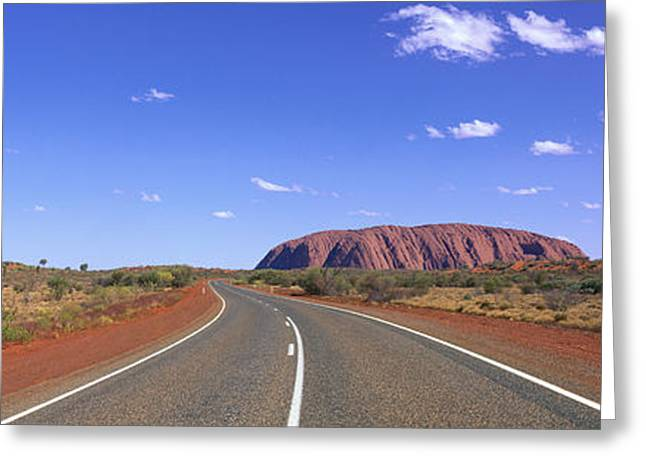 Road And Ayers Rock Australia Greeting Card by Panoramic Images