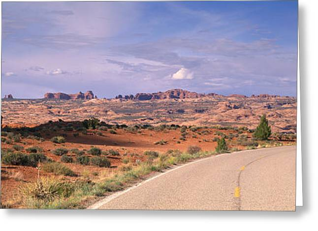Roadway Greeting Cards - Road Courthouse Towers Arches National Greeting Card by Panoramic Images