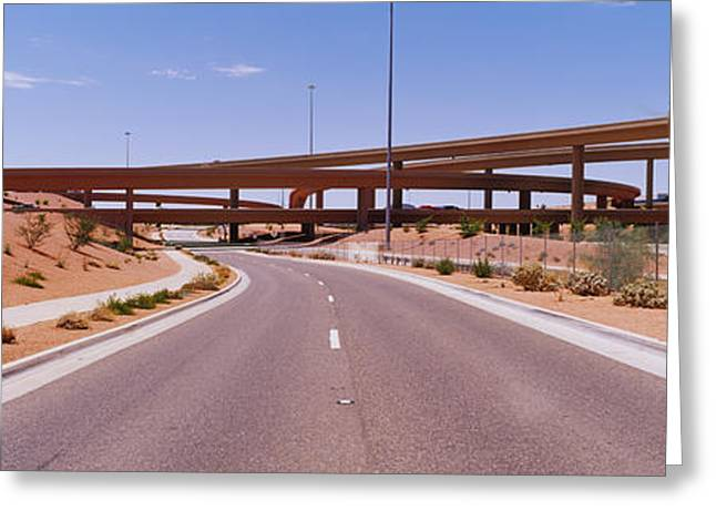 Road Marking Greeting Cards - Road Passing Through A Landscape Greeting Card by Panoramic Images