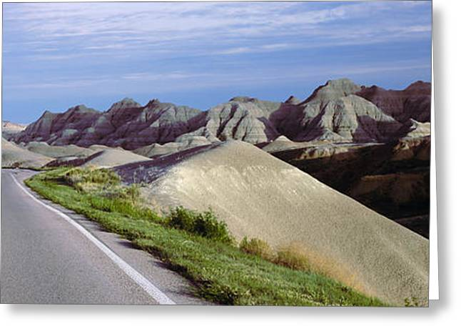 Badlands National Park Greeting Cards - Road Passing Through The Badlands Greeting Card by Panoramic Images