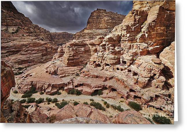 Kultur Greeting Cards - rock landscape with simple tombs in Petra Greeting Card by Juergen Ritterbach