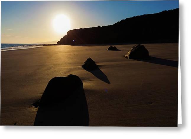 Rocks On Sandy Beach At Sunset Greeting Card by Wladimir Bulgar