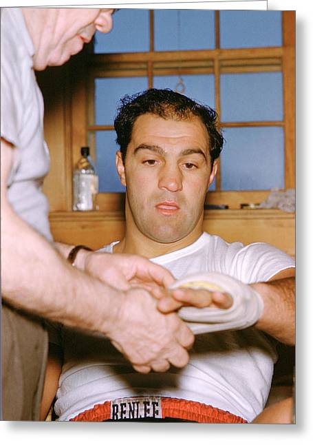 Marciano Greeting Cards - Rocky Marciano Getting Taped Up Greeting Card by Retro Images Archive