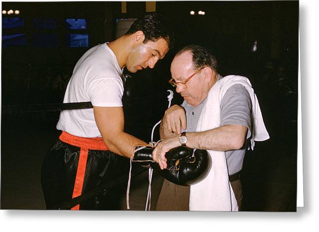 Marciano Greeting Cards - Rocky Marciano Looking At Glove Greeting Card by Retro Images Archive