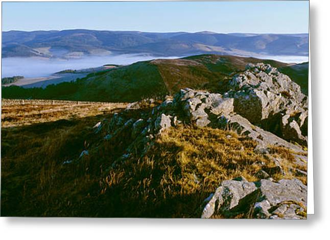 Border Photographs Greeting Cards - Rocky Outcrop Atop Hills At Misty Greeting Card by Panoramic Images