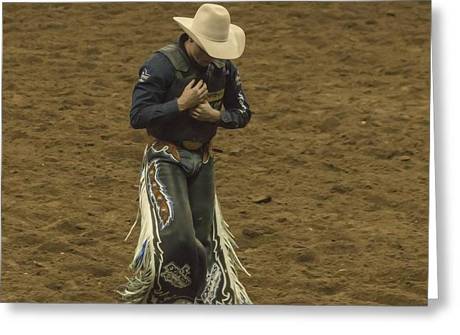Rodeo Cowboy Dusting Off Greeting Card by Janice Rae Pariza