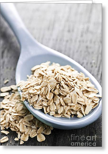 Oatmeal Greeting Cards - Rolled oats in spoon Greeting Card by Elena Elisseeva