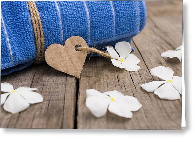 Treatment Greeting Cards - Rolled up towel and paper heart Greeting Card by Aged Pixel