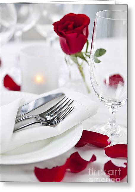 White Rose Greeting Cards - Romantic dinner setting with rose petals Greeting Card by Elena Elisseeva