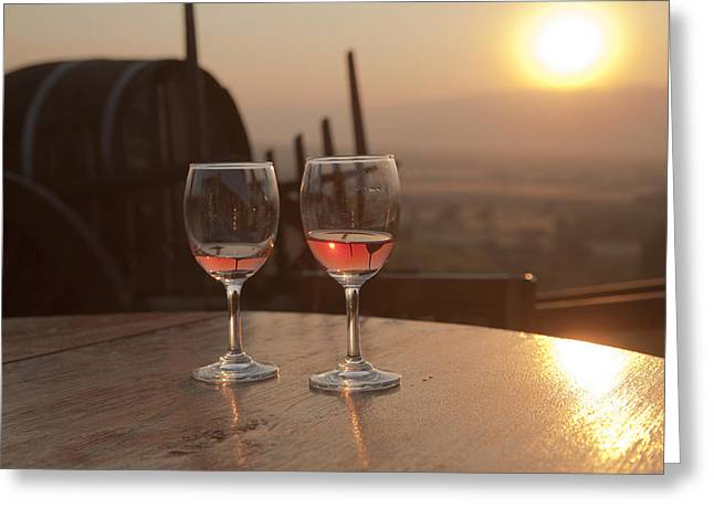 Champagne Glasses Greeting Cards - Romantic sunset with a glass of wine Greeting Card by Maria Heyens