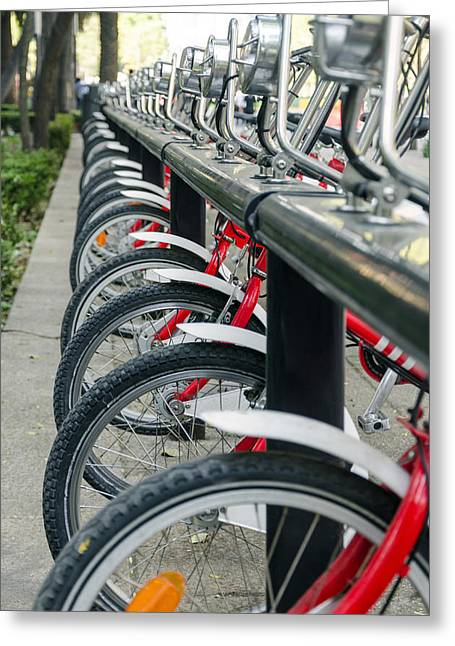 Metal Tires Greeting Cards - Row of Public Bicycles Greeting Card by Jess Kraft