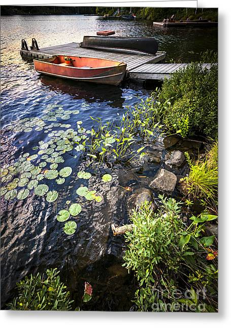 Canoe Greeting Cards - Rowboat at lake shore Greeting Card by Elena Elisseeva
