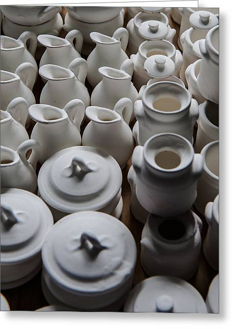 Pottery Pitcher Greeting Cards - Rows of white earthenware jugs Greeting Card by Joseph Amaral