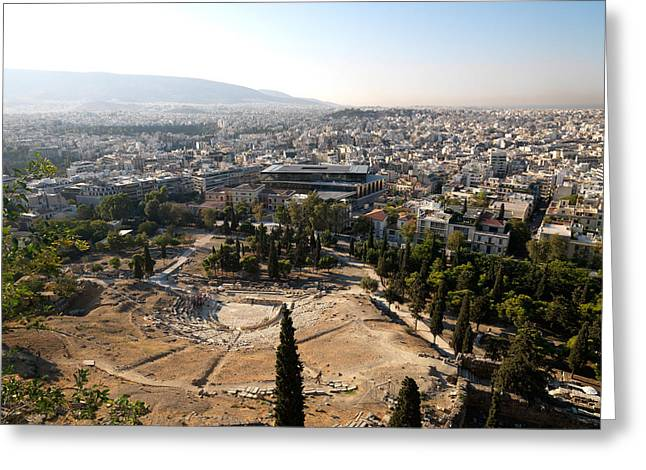 Acropolis Greeting Cards - Ruins Of A Theater With A Cityscape Greeting Card by Panoramic Images