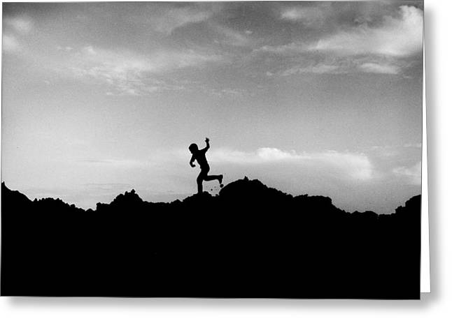 Mid West Landscape Art Greeting Cards - Running Boy Silhouetted against Dramatic Sky Greeting Card by Donald  Erickson