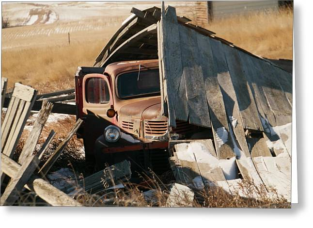 Old Relics Greeting Cards - Rust under the fallen barn in Navaho Montana Greeting Card by Jeff  Swan