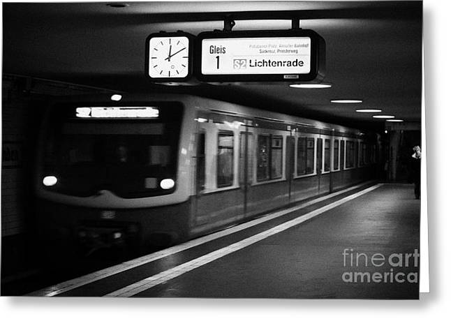 s-bahn train speeding through unter den linden underground station Berlin Germany Greeting Card by Joe Fox