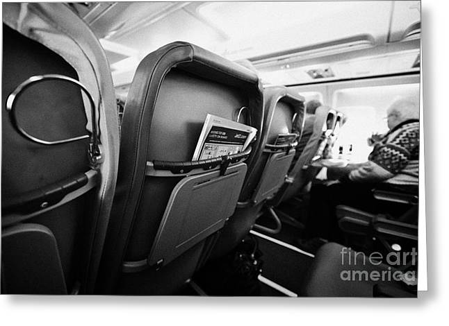 Cabin Interiors Photographs Greeting Cards - Safety Card And In Flight Magazine In Seat Pocket Interior Of Jet2 Aircraft Passenger Cabin In Fligh Greeting Card by Joe Fox