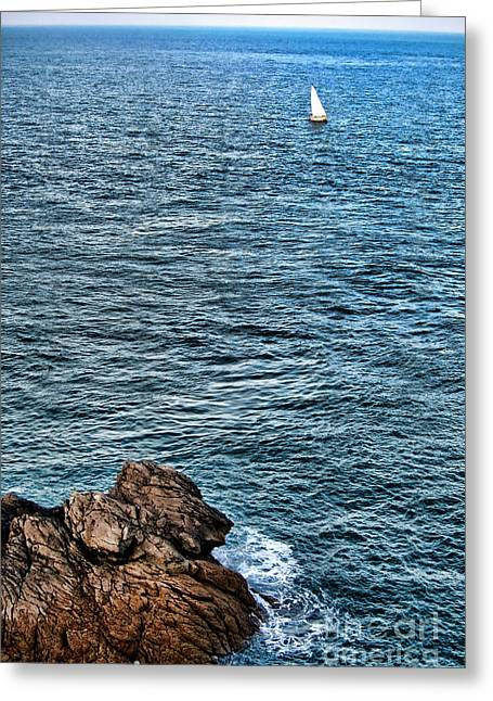 Choppy Water Greeting Cards - Sailboat along Rocky Coastline Greeting Card by Olivier Le Queinec