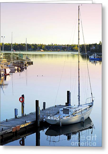 Docked Sailboats Greeting Cards - Sailboat at sunrise Greeting Card by Elena Elisseeva