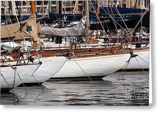 Docked Sailboats Photographs Greeting Cards - Sailboat Hulls in the Port Greeting Card by John Rizzuto
