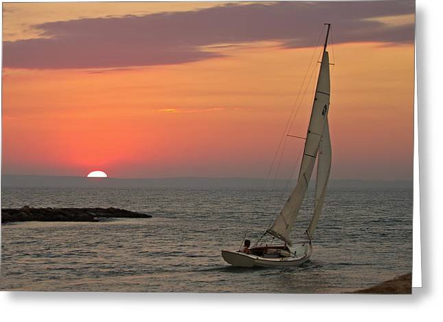 Heading Out Greeting Cards - Sailboat sunset Greeting Card by Jack Nevitt