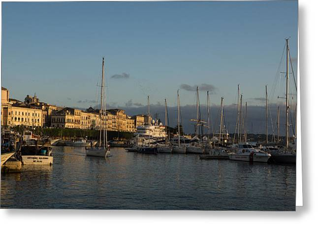 Blue Sailboats Greeting Cards - Sailing Out Of Syracuse Sicily  Greeting Card by Georgia Mizuleva