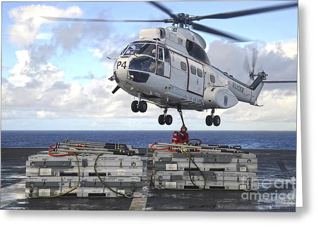 At Arrivals Greeting Cards - Sailors  Attach Cargo Legs To An Sa330j Greeting Card by Stocktrek Images