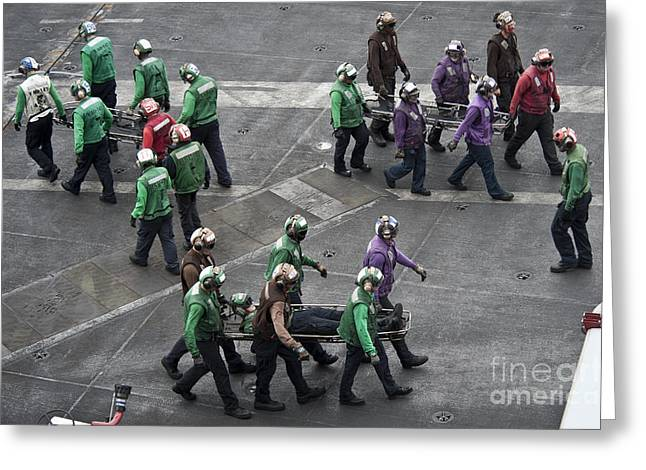 Cooperation Greeting Cards - Sailors Carry Stretchers In Response Greeting Card by Stocktrek Images