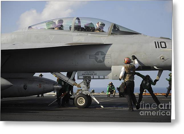 Military Airplanes Greeting Cards - Sailors Check An Fa-18f Super Hornet Greeting Card by Stocktrek Images