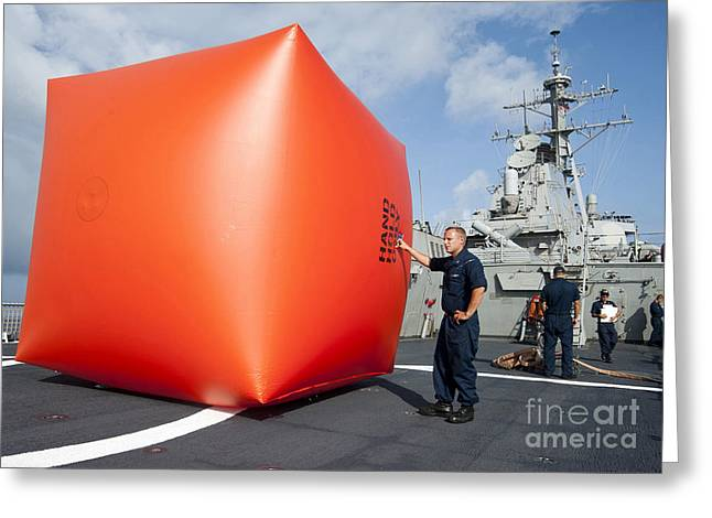 Carat Photographs Greeting Cards - Sailors Prepare To Deploy A Killer Greeting Card by Stocktrek Images