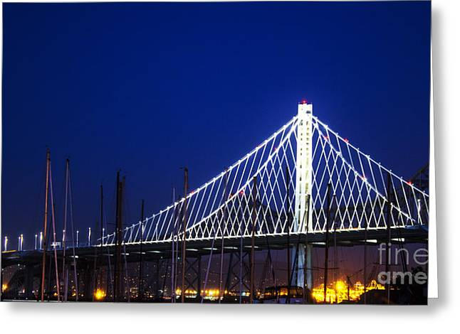 Architectural Treasure Greeting Cards - San Francisco - New and Old Eastern Bay Bridge Spans at Dusk Greeting Card by Jacqueline Barden