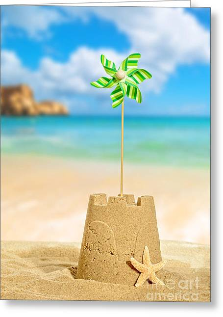 Golden Sand Greeting Cards - Sandcastle With Pinwheel Greeting Card by Amanda And Christopher Elwell